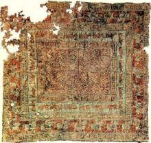 The Pazyryk carpet dated from the 5th. Century B.-C. was               discovered on the Oukok plateau where the pazyryk people used to live.